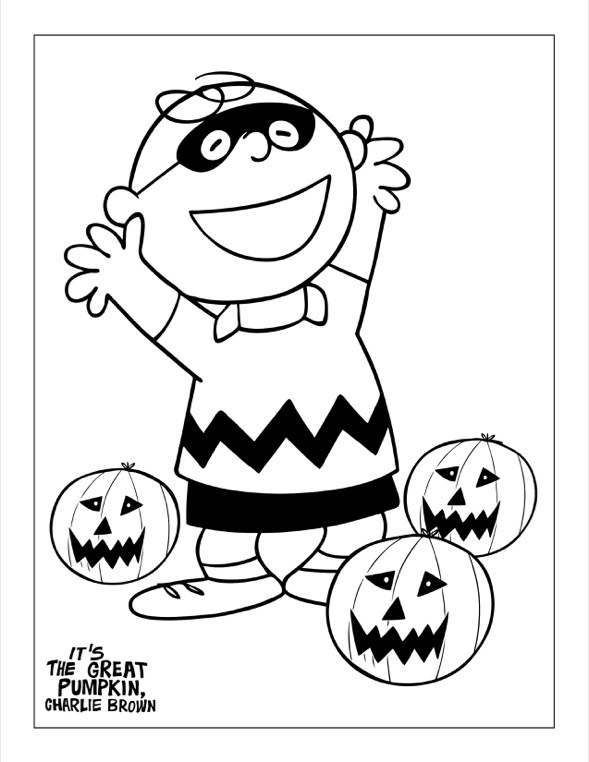 A boy in a Halloween mask cheering surrounded by jack-o-lanterns