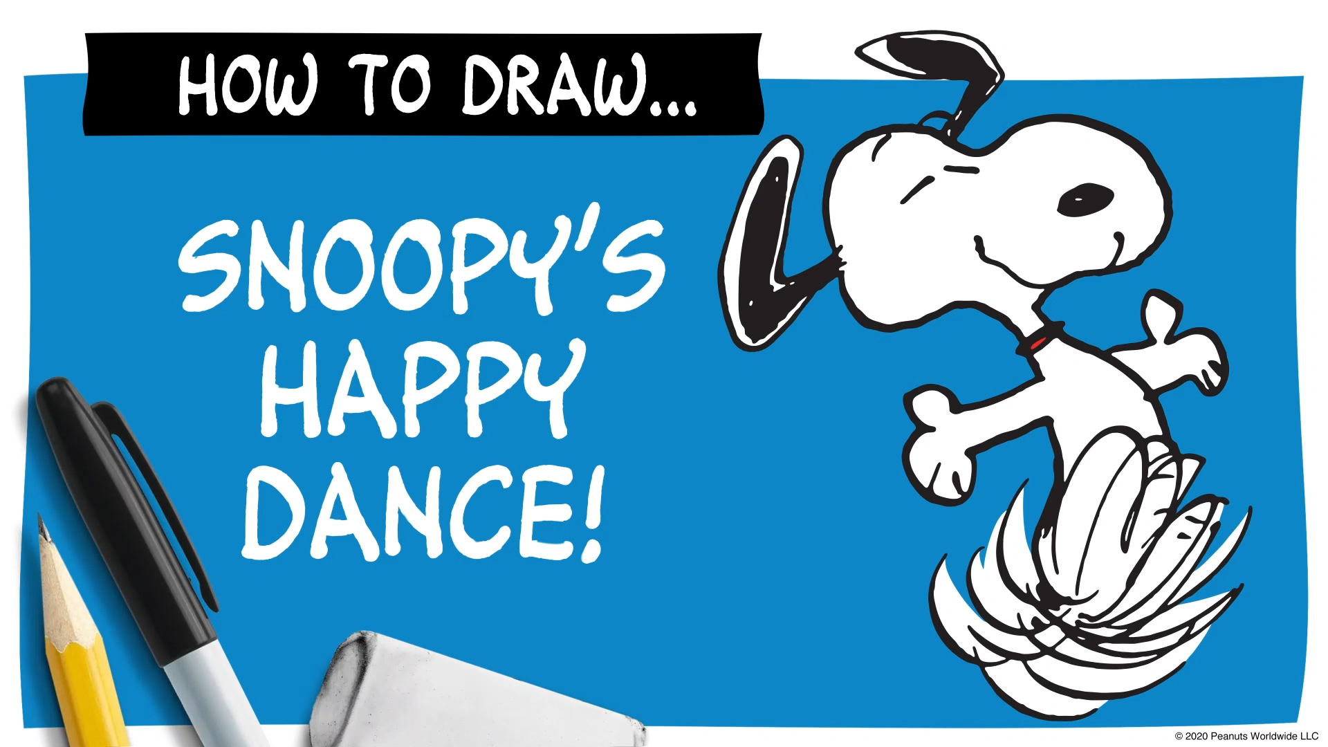 A black and white beagle dancing happily next to a pen and pencil