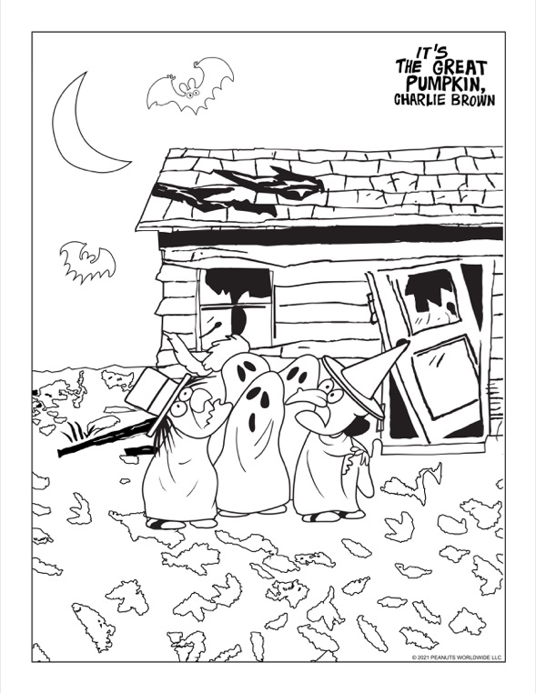 kids in Halloween costumes outside a run-down house with bats flying in the air
