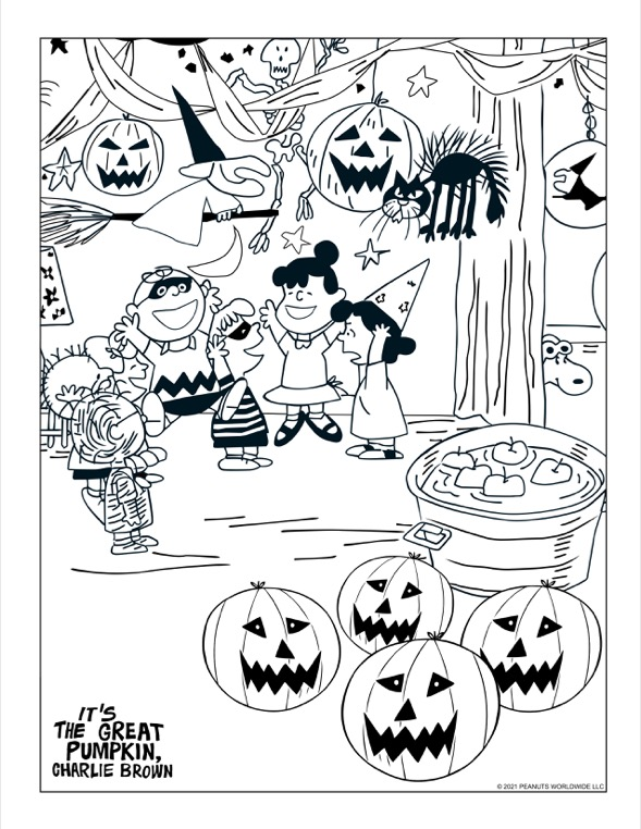 Kids is costumes cheering at a Halloween party