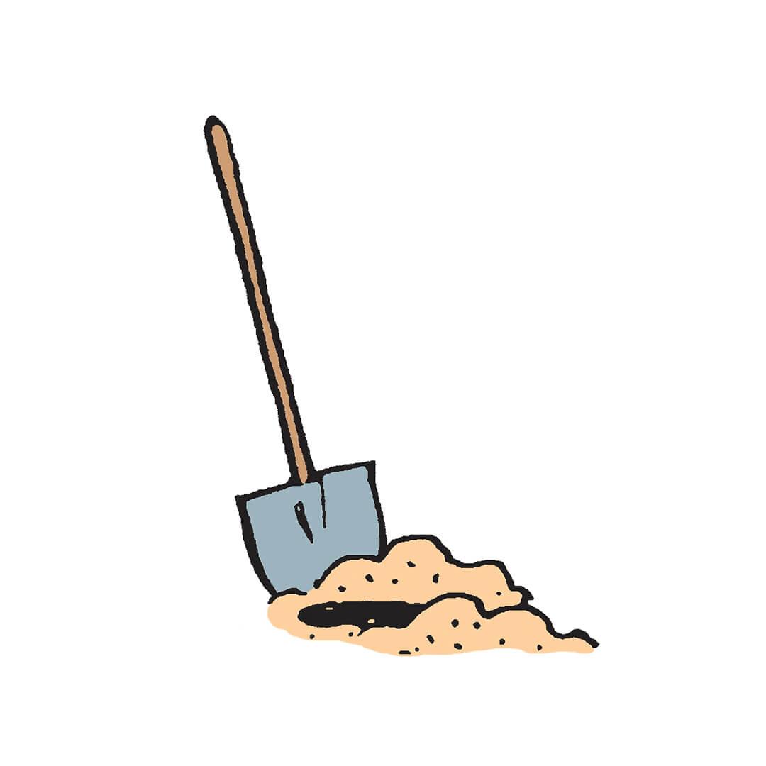 Shovel in pile of dirt
