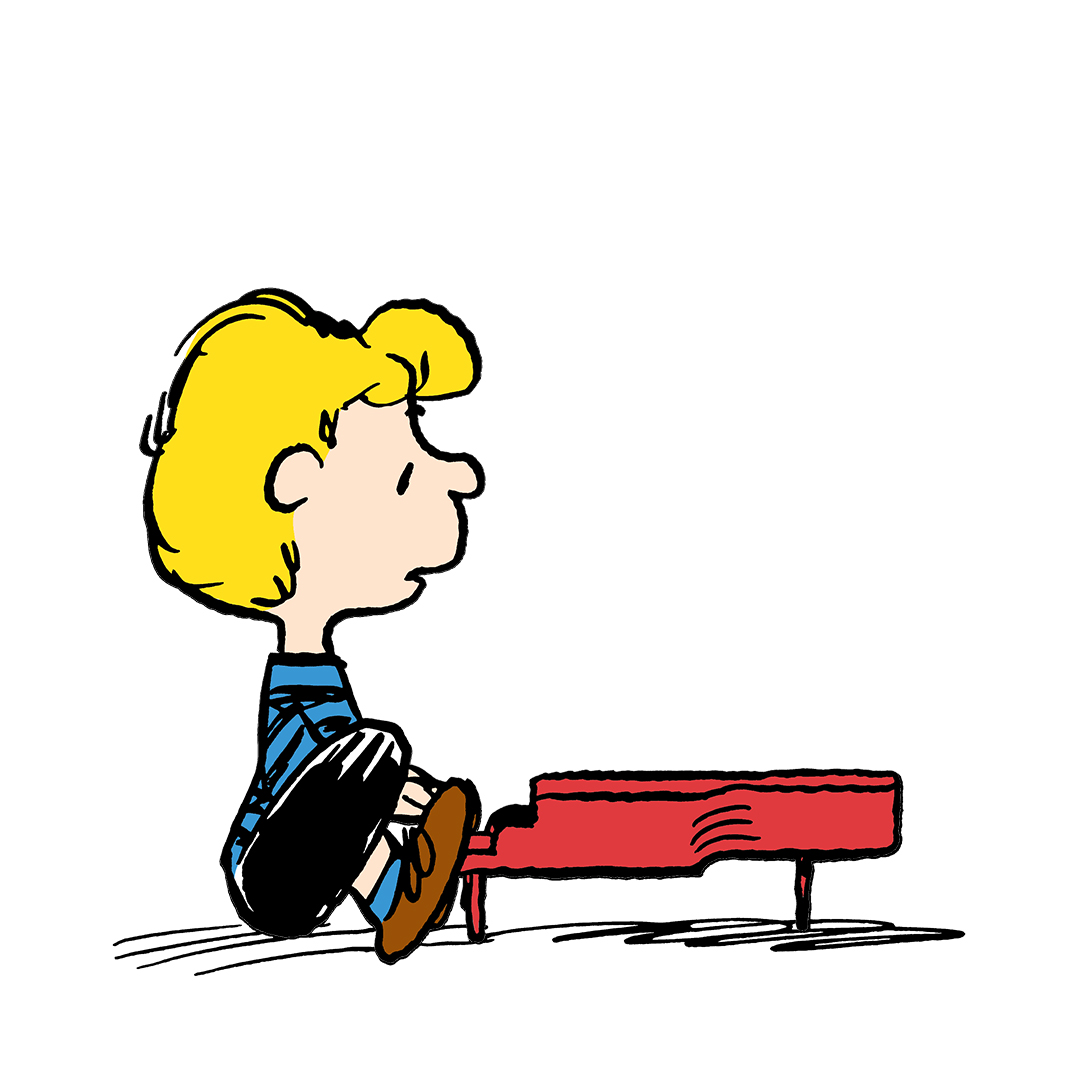 A boy with yellow hair sitting in front of a red piano