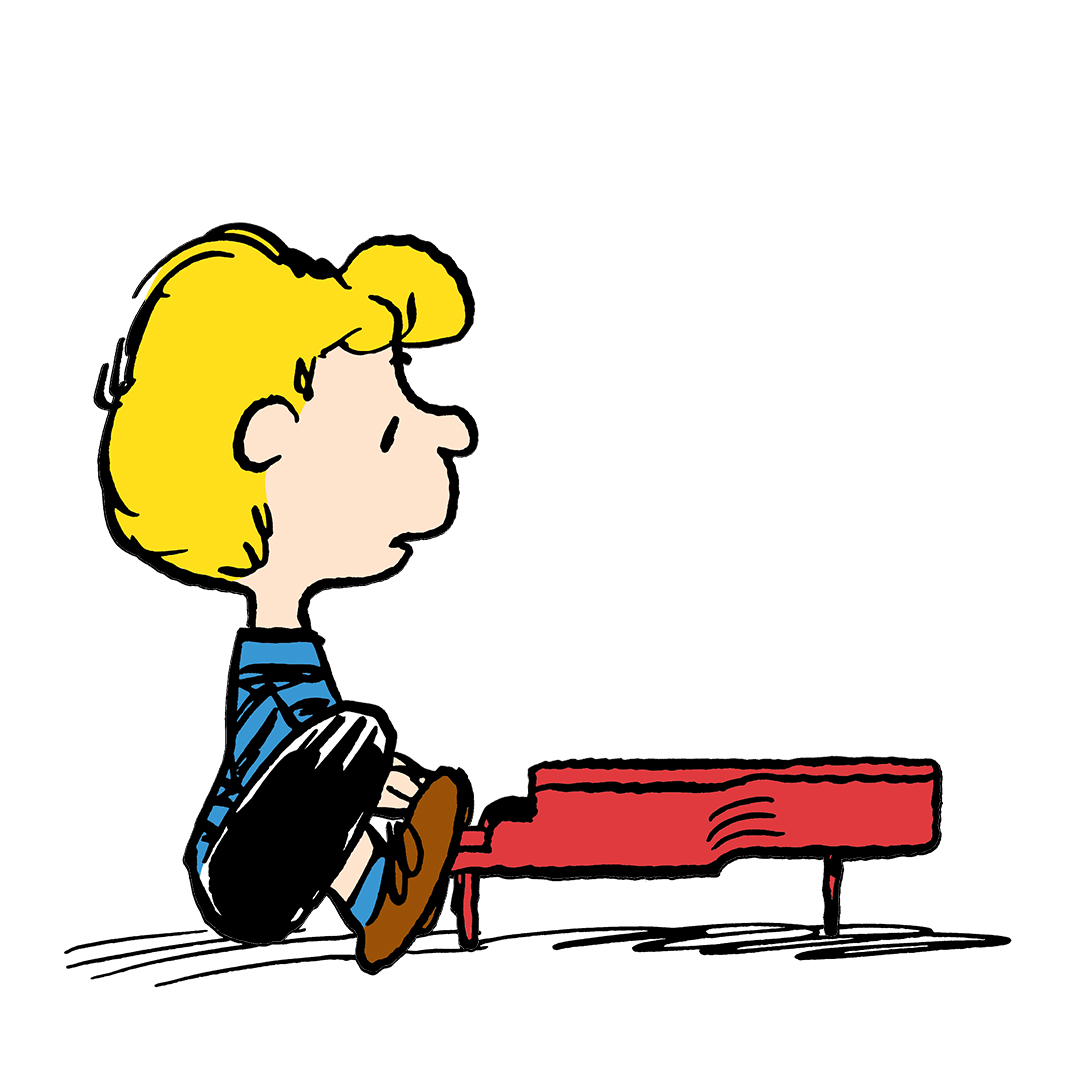 Image of a boy with yellow hair sitting in front of a red piano